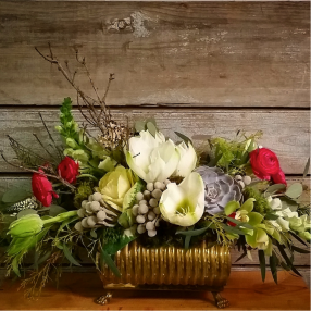 Different Elements: Brides are using different pieces in with the flowers. Succulents, Air Plants, Branches, Lichen, Moss, etc. are becoming more popular. These elements add more texture and appeal to the centerpiece.